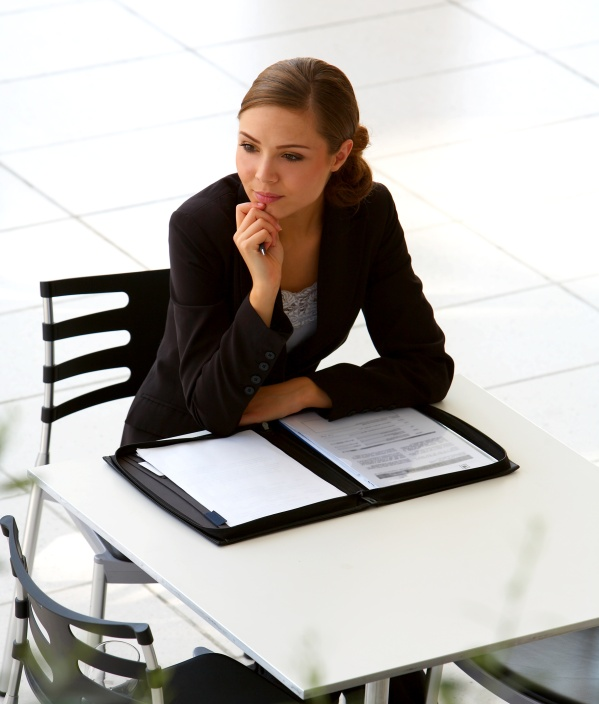 young businesswoman wondering